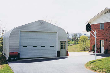 steel_building_images/a_model/garage-behind-house-steel-arch-buildings-a-model.jpg